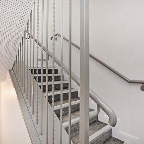 Carpeted hallways and bespoke balustrade