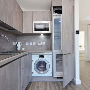 Integrated microwave and fridge freezer